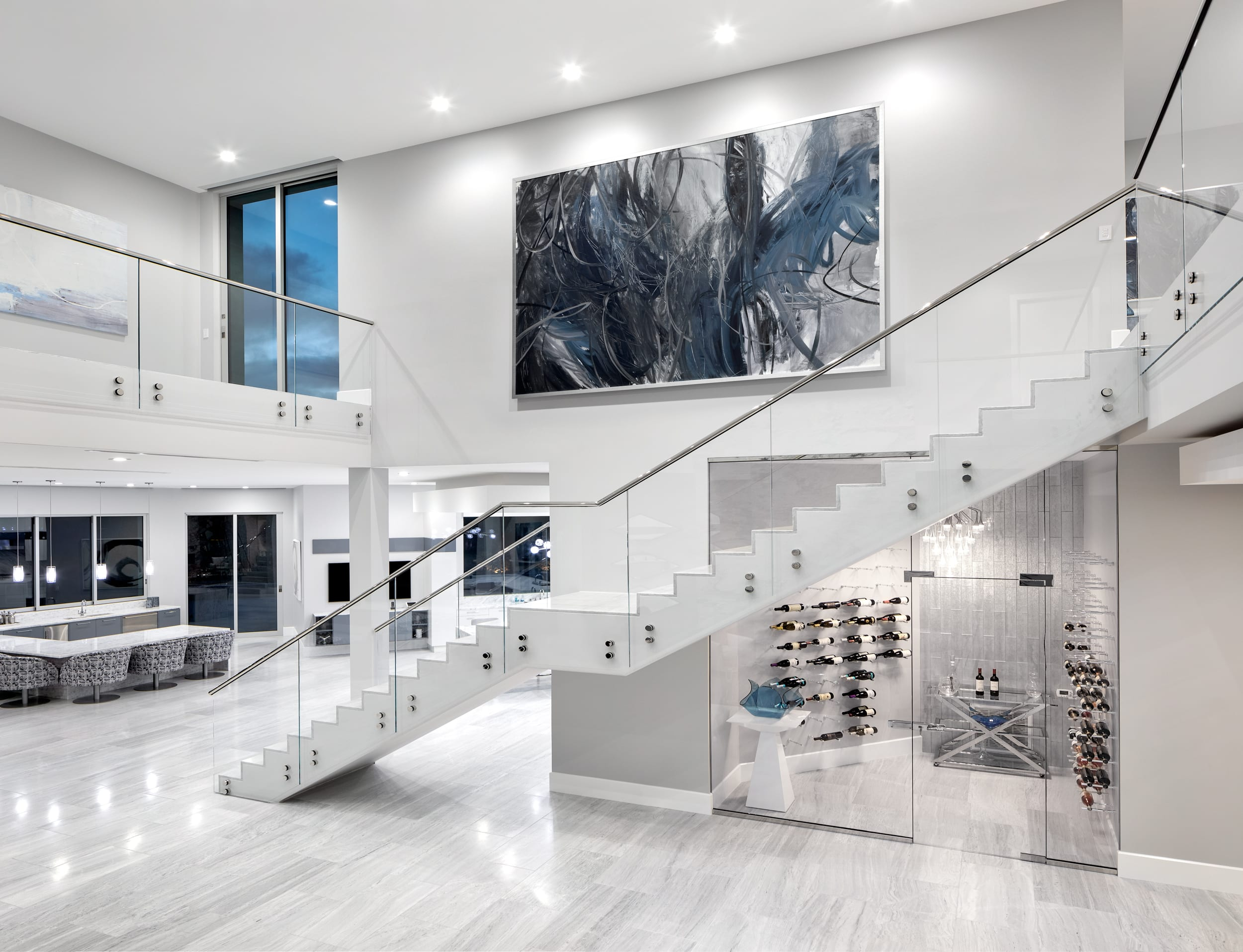 The interior of a custom modern home with a staircase created by JD Stairs