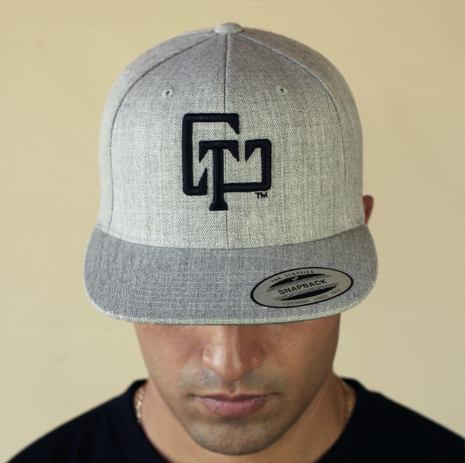 A gray baseball cap with the U Chase This logo