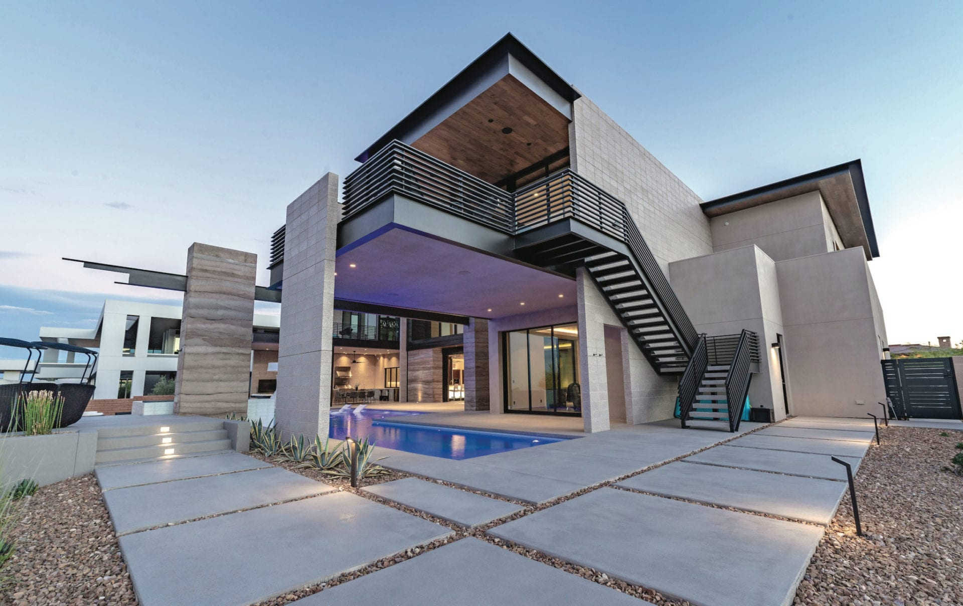 A contemporary modern home featuring metal work designs by JD Stairs