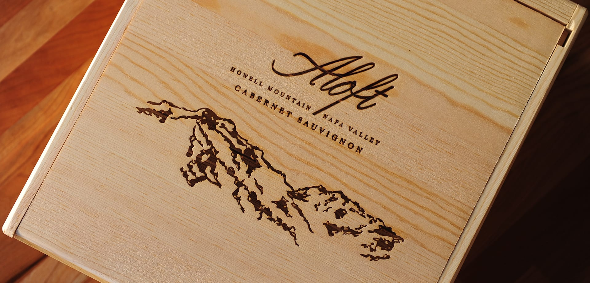 The top of a wooden case of Aloft Wine Cabernet Sauvignon.