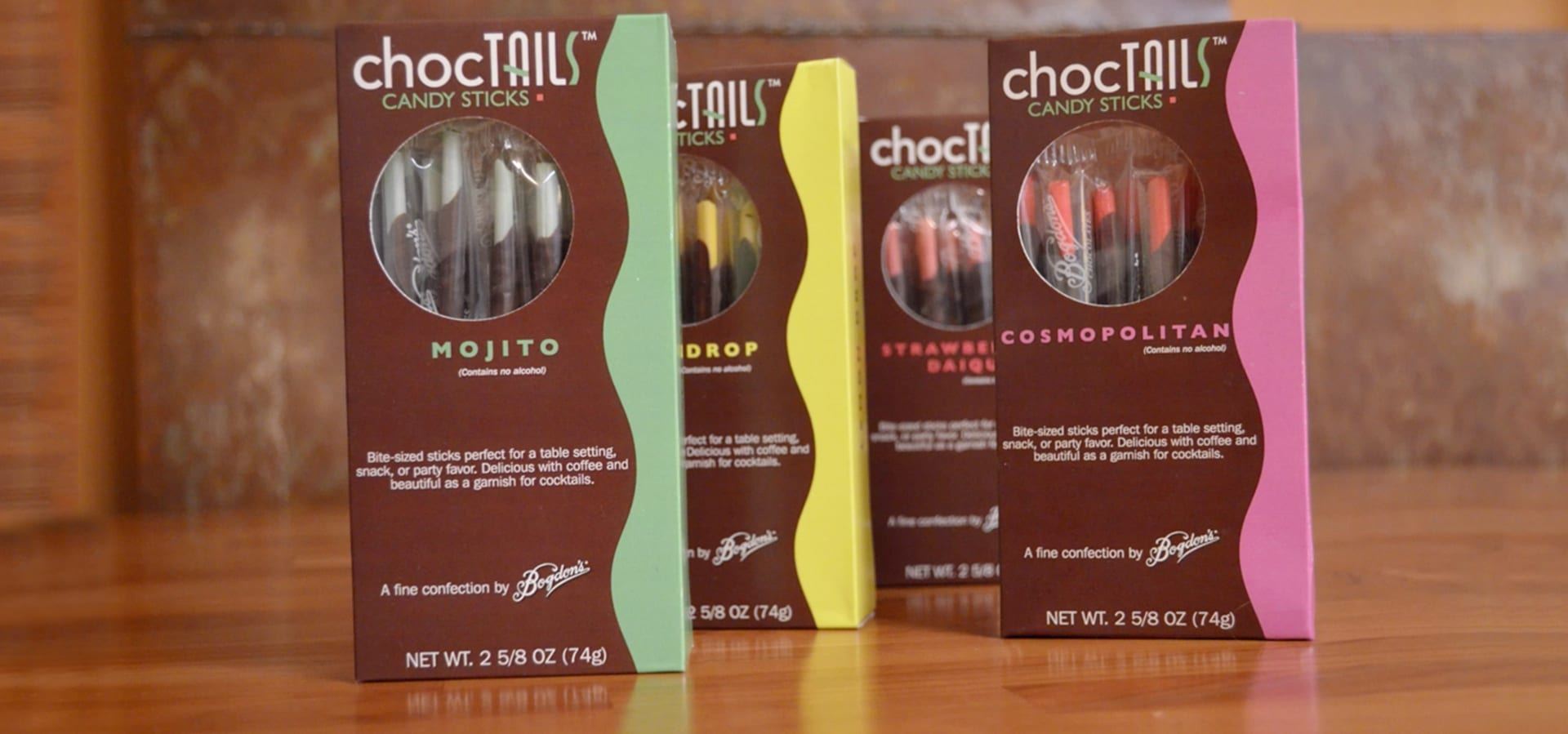 4 flavors of Choctails candy sticks: mojito, lemon drop, strawberry daiquiri, and cosmopolitan