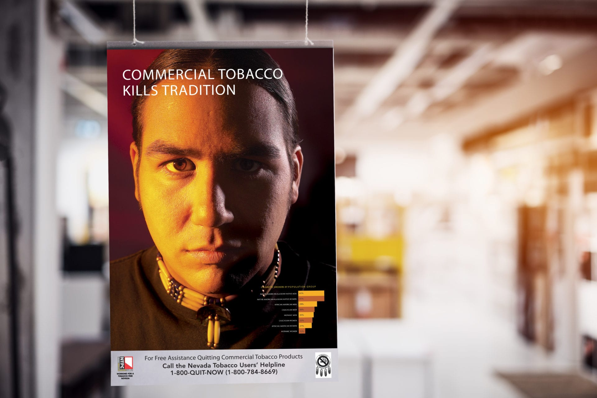 "A poster with a picture of a Native American for the anti-smoking campaign saying ""Commercial Tobacco Kills Tradition"""