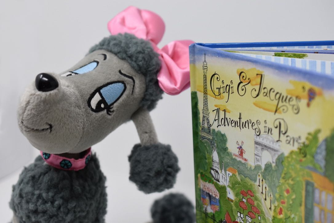 A picture of the Gigi plush toy and the book Gigi & Jacques Adventures in Paris
