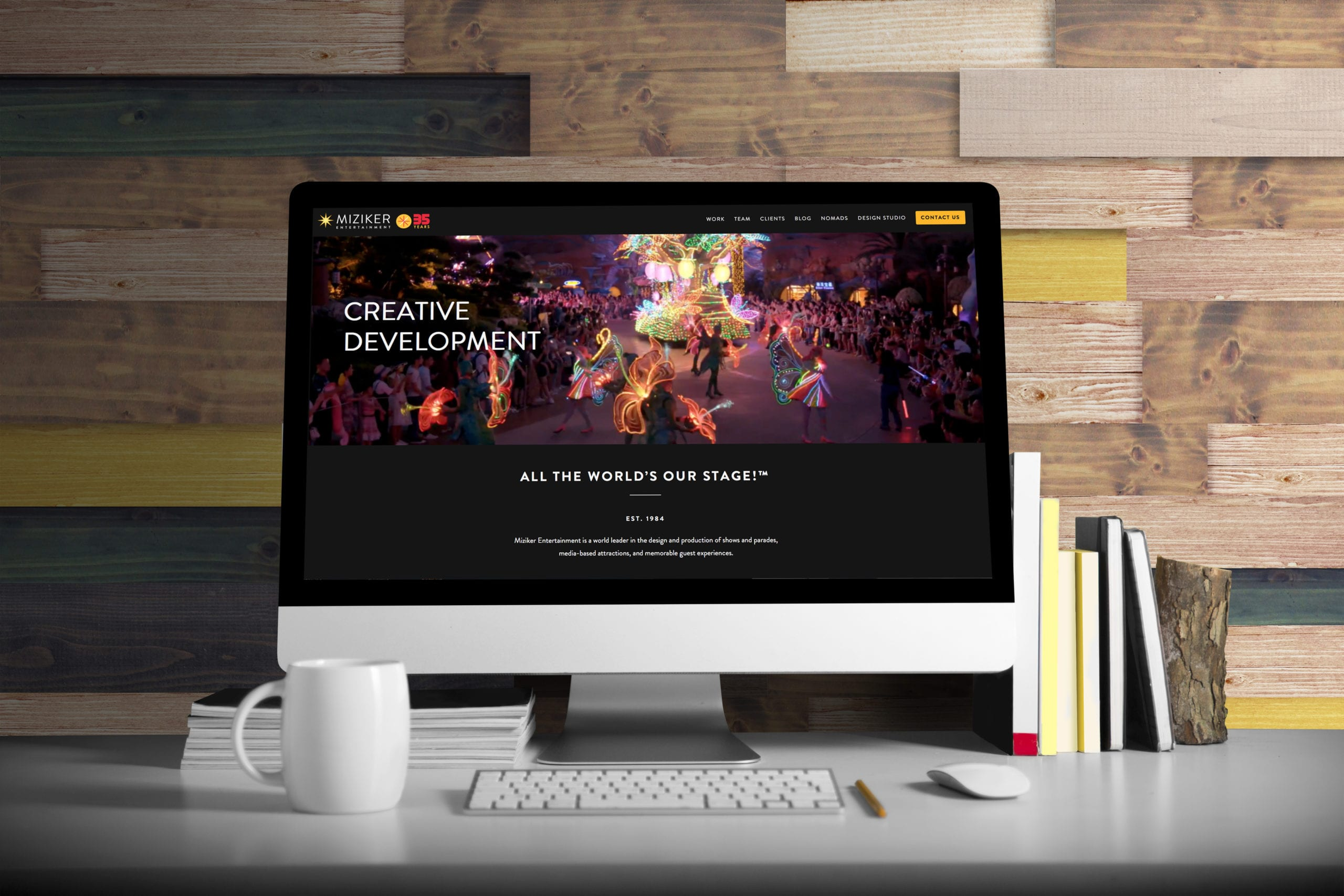 A desktop with the Miziker Entertainment website designed by Canyon Creative