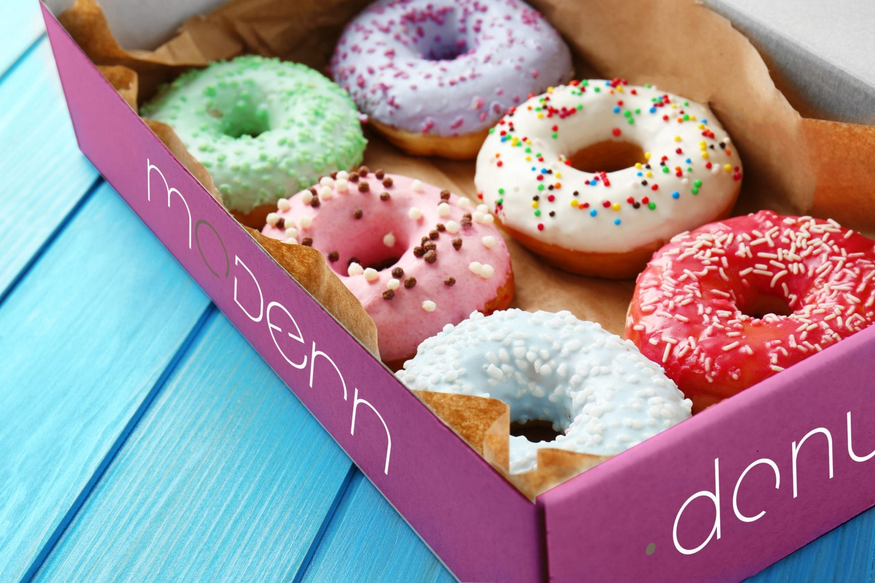 A half dozen delicious donuts by Modern Donuts, branding by Canyon Creative