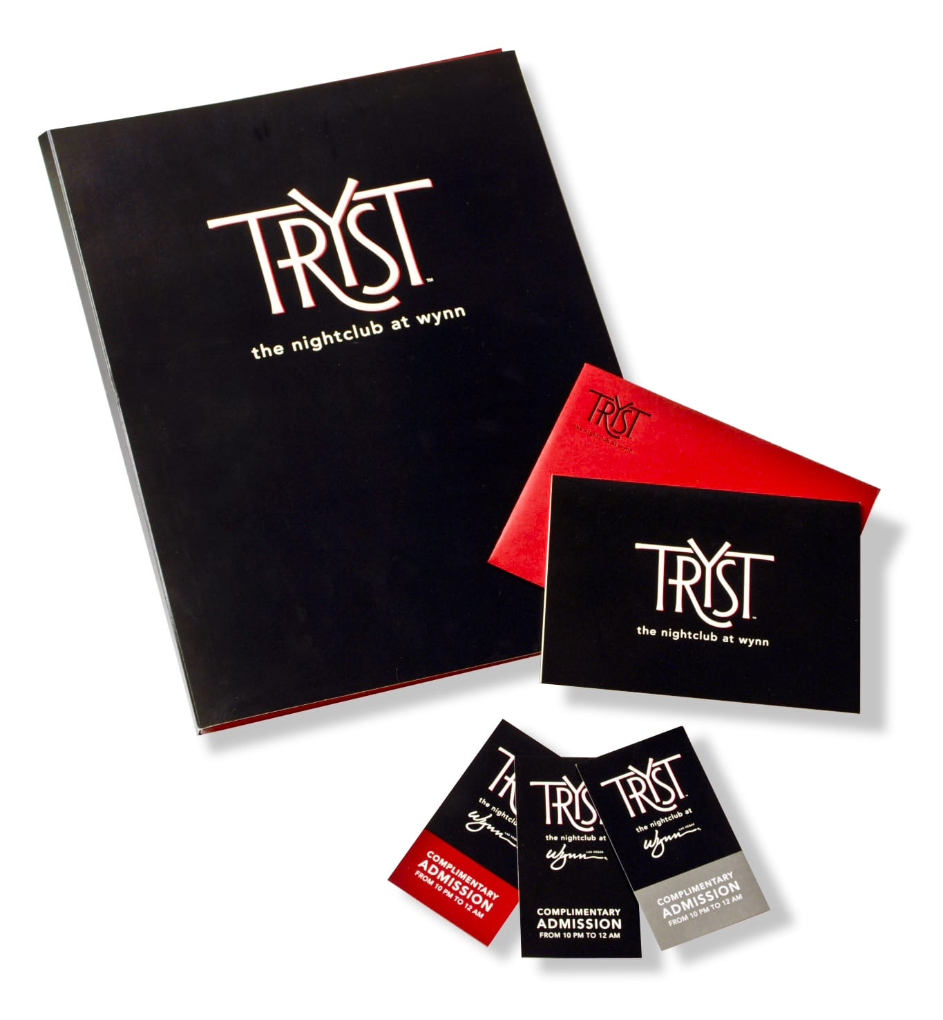A group of Tryst nightclub branding featuring menus, business cards, and marketing.