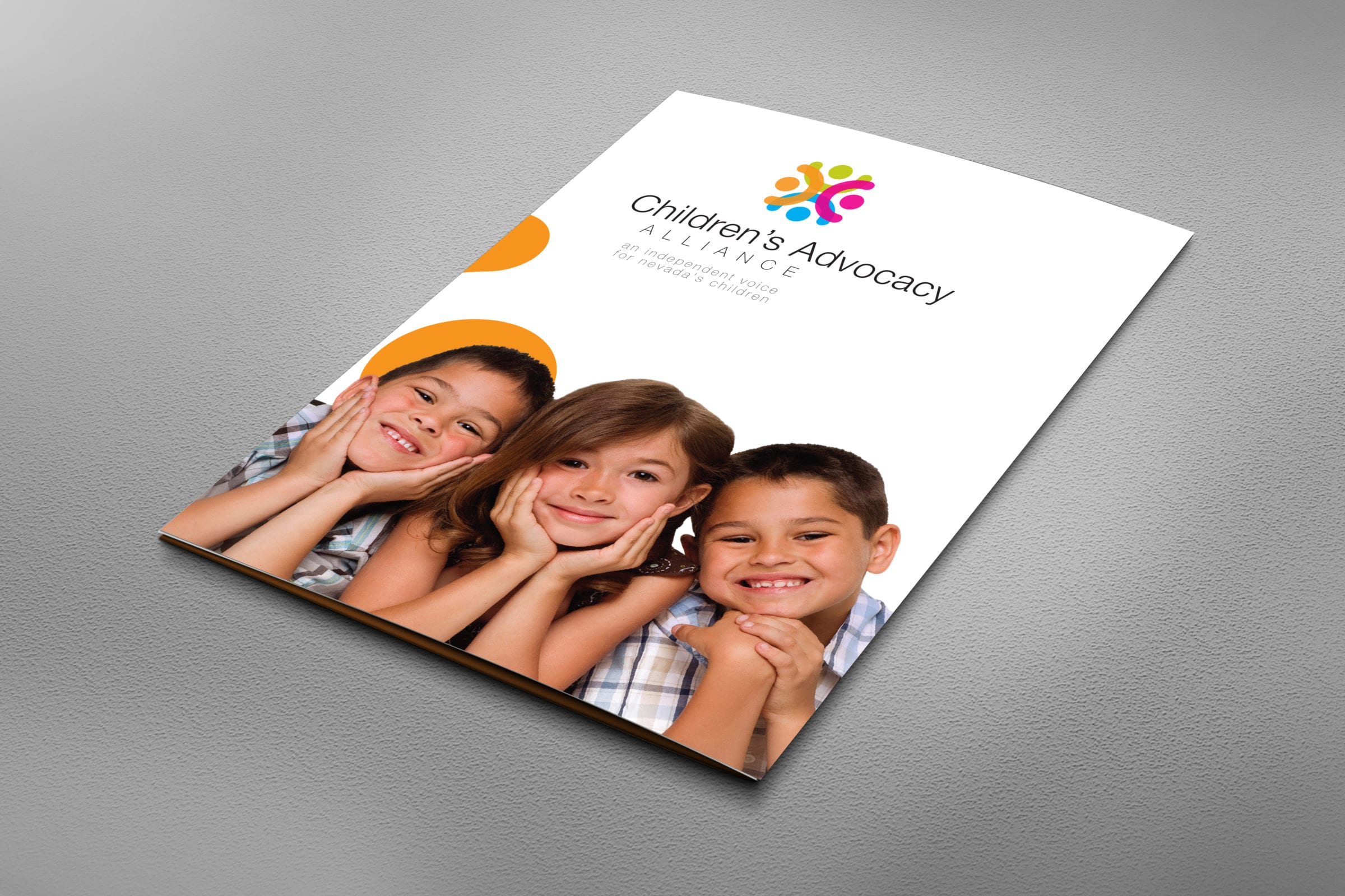 Children's Advocacy Alliance branded folder with children pictured on the cover