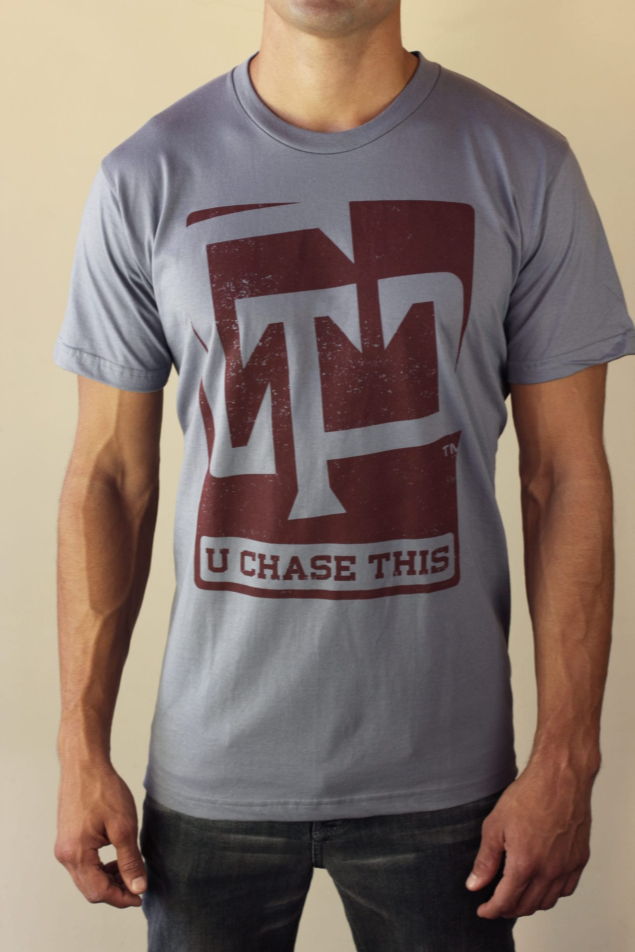 """A Canyon Creative work, the """"U Chase This"""" logo design on a t-shirt."""