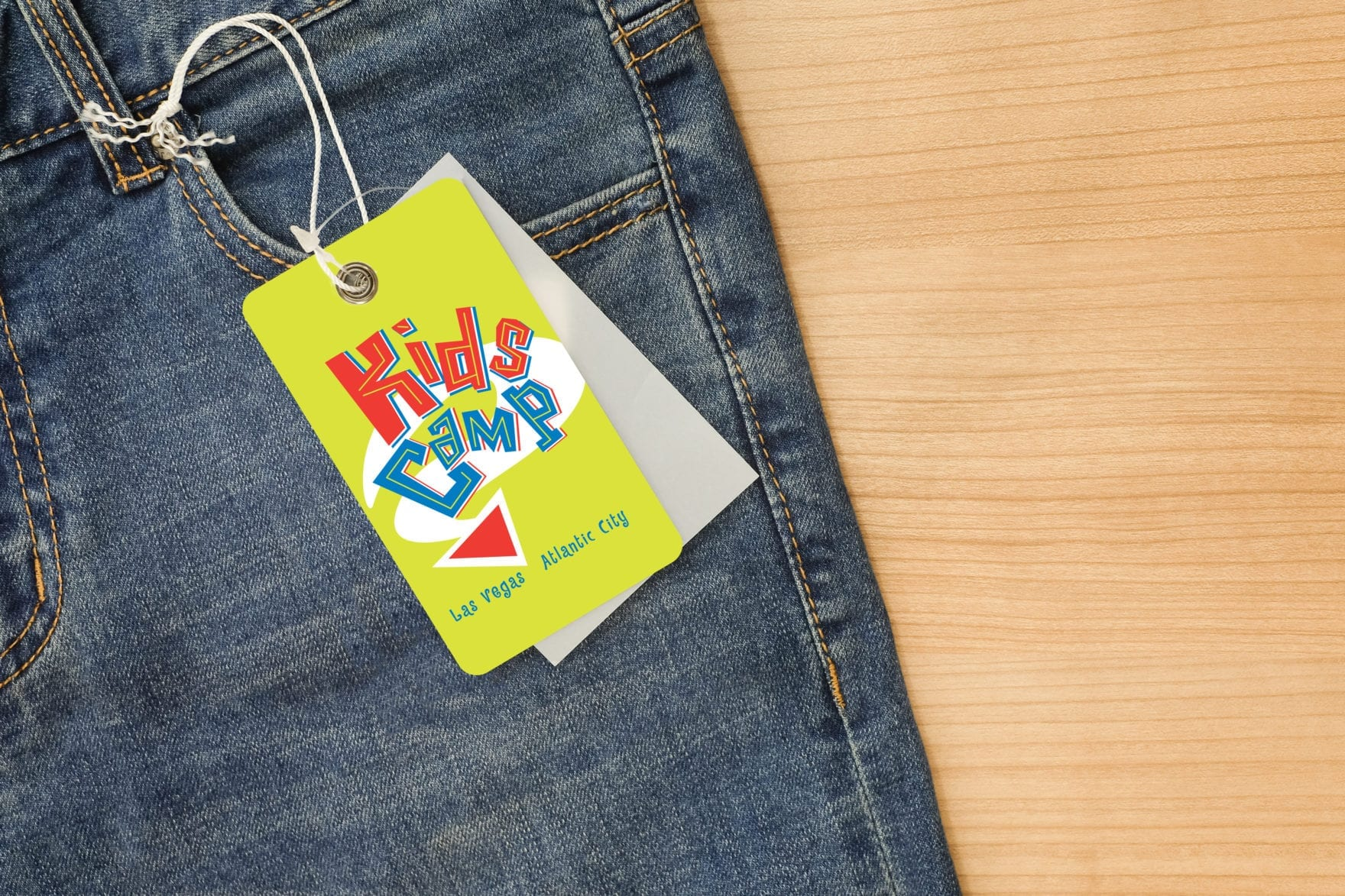 A pair of jeans with a tag for Kids Camp brand, designed by Canyon Creative