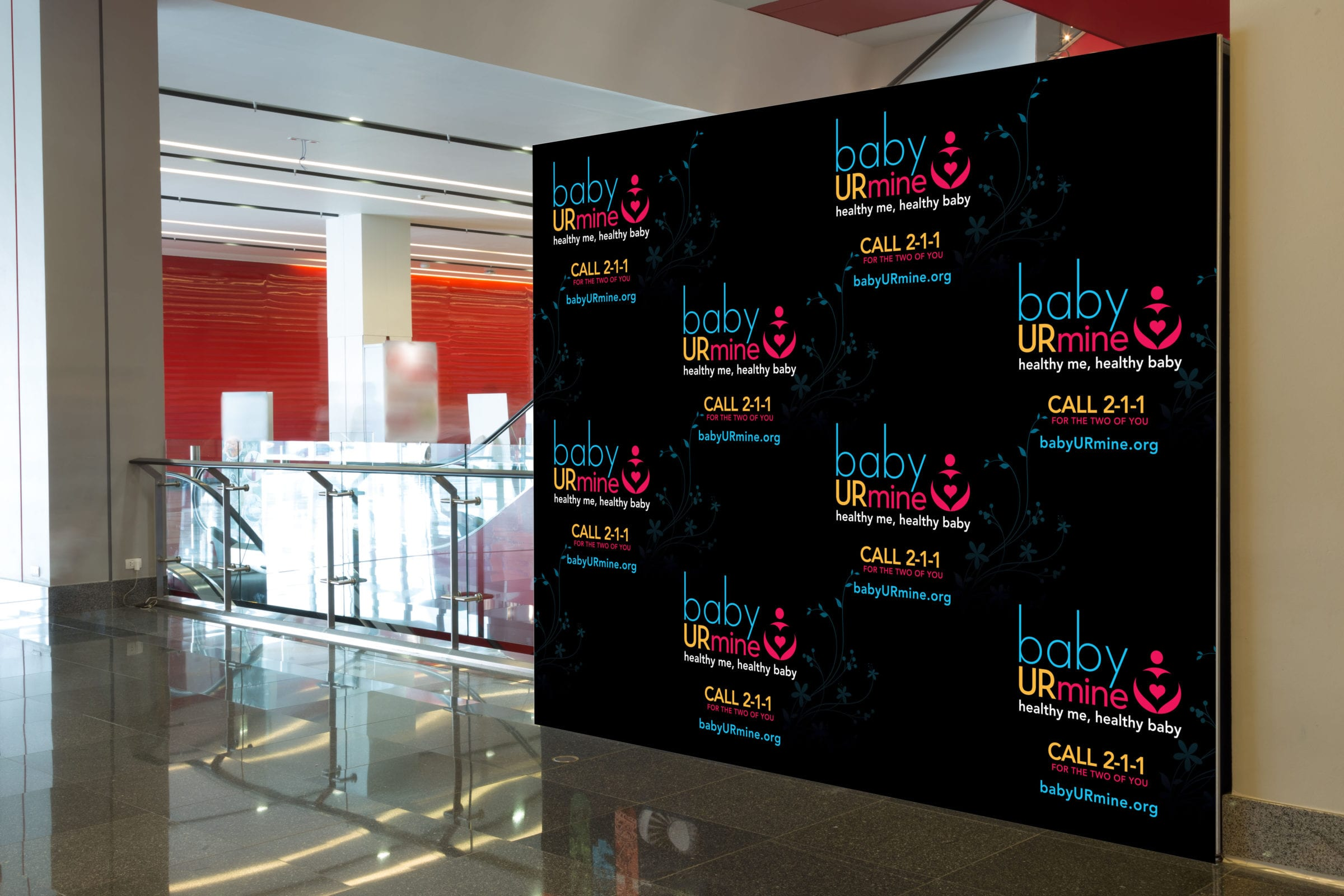 "A promotional wall of the ""Baby Ur Mine"" logos."