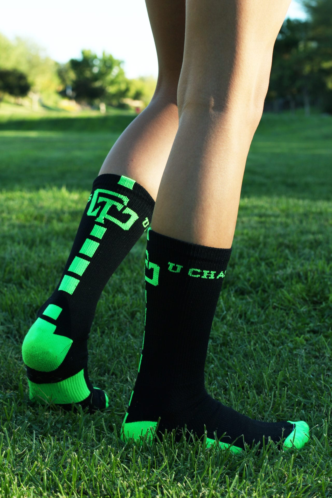 U Chase This branded black socks with lime green branding