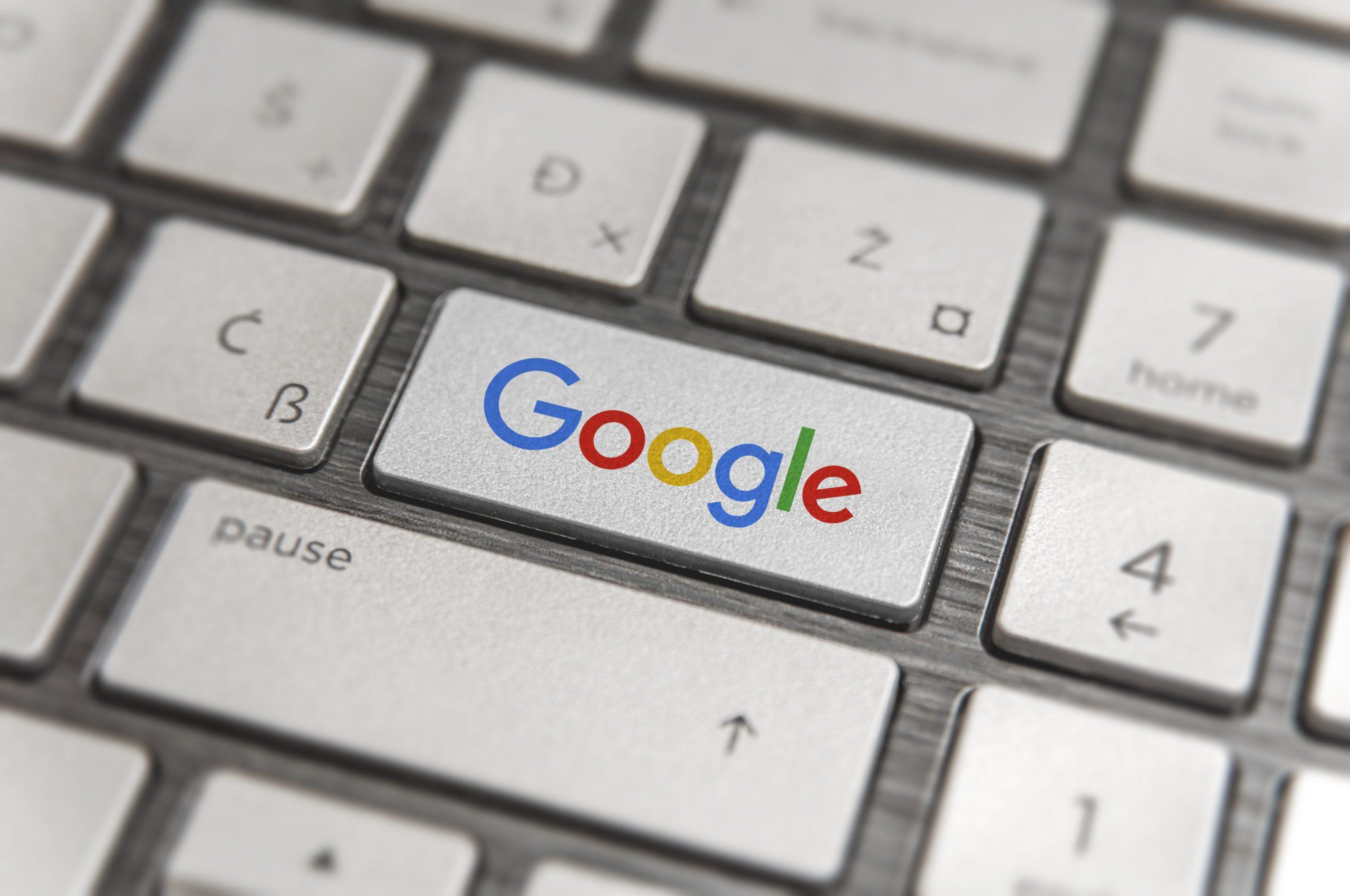 A keyboard with a Google key.
